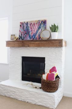 White Painted Stone & Shiplap Fireplace Makeover Check out and vote for my painted stone fireplace and rustic mantel before and after – Simple Stylings – www. White Stone Fireplaces, Painted Stone Fireplace, Stone Fireplace Makeover, Paint Fireplace, Shiplap Fireplace, Rock Fireplaces, White Fireplace, Fireplace Remodel, Fireplace Surrounds