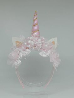 light pink color one a hard ribbon covered headband one size fits most