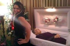 Oh.my.god. Is she really posing in front of Gramma in her casket??!!