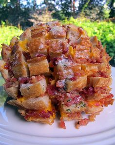 "This looks downright weird. It is called 'Cheddar, Bacon, Ranch, Pulls'. I am just waiting for the next big pot luck, or reception in life to have tables themed and stacked with Pinterest inspired ""pull foods"" (blooming onion pulled appetizer, cheddar/bacon/ranch pulls, pulled chicken crescents, pulled pork in buns and stacked, pull apart carmel rolls and breads for dessert...)."