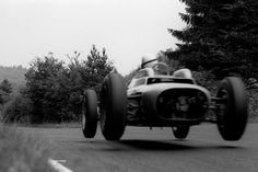 1962 German GP- Swedish Formula One driver Jo Bonnier taking his Porsche 804 car for a short flight on the Nurburgring. Bonnier finished in the race. Porsche 911 Rsr, Formula One, Black And White Photography, Art Direction, Grand Prix, Race Cars, Antique Cars, Art Photography, F1