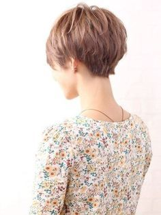This is the back of a pixie cut that's not too short; a bit fuller. I think this is much more feminine than those that are cut closer to the skull.:
