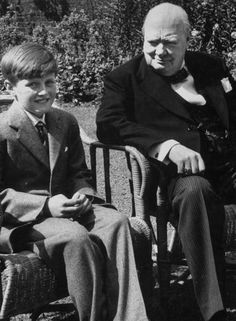 Winston Churchill seated in chair in garden of 10 Downing Street with his grandson, Winston Churchill II sitting beside him, July 1952. Photographer: Carl Mydans