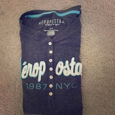 """Aeropostale long sleeve shirt! OPEN TO ANY OFFERS! Grey half button down shirt with """"Aeropostale 1987 NYC"""" printed on it Aeropostale Tops Tees - Long Sleeve"""