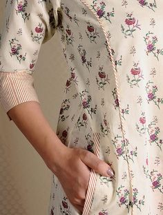 Ivory-Pink Printed Cotton Kurta with Pockets Kurti Sleeves Design, Sleeves Designs For Dresses, Neck Designs For Suits, Kurta Neck Design, Dress Neck Designs, Sleeve Designs, Sewing Clothes Women, Clothes For Women, Printed Kurti Designs
