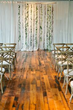 What about this instead of the arbor ? Might save money ! But way more hanging greenery Fresh Greenery Ceremony Backdrop | Brides.com