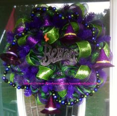 """""""Yours Truly, Julie"""" original Halloween wreath: Layers and layers of purple, green and black plaid mesh with lime green and purple mesh ribbon. Hand strung foam beads on sturdy craft wire. Polished off with four cute witches hats and a black glitter """"Beware"""" sign. A perfect non-traditional Halloween wreath! https://www.facebook.com/yourstrulyjulie42"""