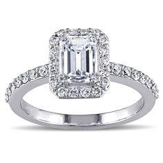 <li>Emerald and round-cut white diamond halo engagement ring</li> <li>14-karat white gold jewelry</li> <li><a><a href='http://www.overstock.com/downloads/pdf/2010_RingSizing.pdf'><span class='links'>Click here for ring sizing guide</span></a></li>