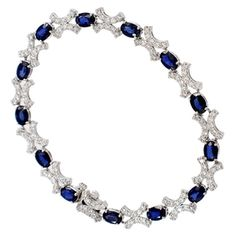 Shop 14KW 8.70ctw Diffused Sapphire Oval 1.85ctw Diamond Rd Bracelet and other jewelry, art, coins, rugs and real estate at www.aantv.com