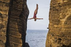 Lysanne Richard of Canada dives from the 27-meter platform during the second round of the fifth stop of the Red Bull Cliff Diving World Series at Islet Franca do Campo, Azores, Portugal on July 17, 2015.