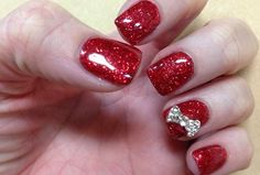 Gel Nail Design With Bright Red Base Glitter And Jeweled Silver Bowtie