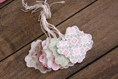 15 handmade tags cut with a double sided vintage style papers. Great for sprucing up all your gifts! Matching handmade flowers sold in a