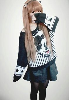 Very kawaii fashion on the edgy side with the mickey mouse sweater, black skirt, and black tights.