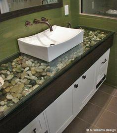 bathroom ideas---river rock under glass countertop.  #kitchentuneupventura #bathroom remodel