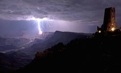 """Lightning strikes the edge of the Grand Canyon, with the majestic """"Indian Watchtower"""" (not actually built by Native Americans)"""