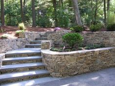 steep hillside renovated with tiered garden and bluestone steps; path from walkout basement to upper deck