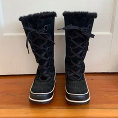 "Women's Tivoli winter boots from Sorel. Black and white rubber on the sole and halfway up the shoe, water-resistant suede on the shoe top and up the shaft. Fleece lined the bottom, with warm fur around the leg and up top. 13"" high. Fully laced, no zipper. Runs true to size, recommended for an 8.5 with thick socks or 9 with thin socks. Worn twice. A scuff on the front of each toe. Sorel Boots, Thick Socks, Winter Boots, Fur, Zipper, Legs, Black And White, Water, Gripe Water"