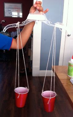 Make a balance scale to learn about weight.