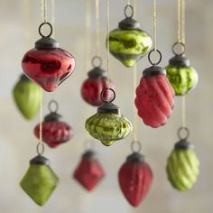 mini baubles combines beautiful onion, drop and diamond shapes with rich antiqued finishes in red and green.