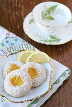 Glorious Treats » Lemon Thumbprint Cookies {Recipe} - trying these soon (will modify with flaxmeal for egg).  A thumbprint recipe that bakes with the jam in the thumbprint.