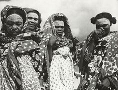 "Africa | ""Msindanu"" women wearing 'beauty masks'.  Anjouan, Comoros.  ca. 1953 | © Peter Leonard Coudert"