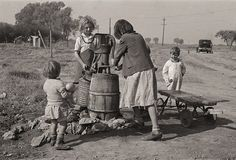 The History Place - Dorothea Lange Photo Gallery: Striving for Normalcy: Water Supply