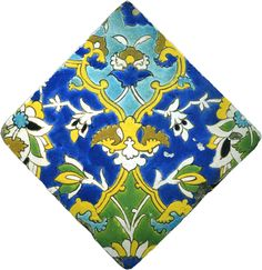 FLOWERS AND LEAVES - Iran (Safavid), 17th century - A tile in the cuerda seca technique depicting a magnificent all over floral design bordered by cartouches. The tile is coloured with brown, yellow, blue, turquoise, green and white glazes on a dark blue ground.