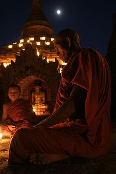 Monks, candles & a full moon. Photo by, Sara Heinrichs