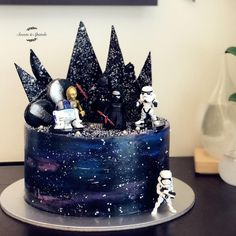 After the decors and toppers were up! Star Wars Theme Galaxy Cake Adorned with black chocolate sail, macarons & splashes of silver!…