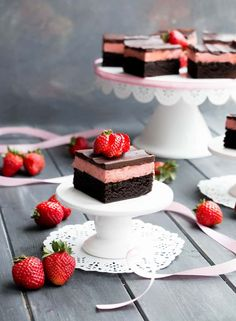 Strawberry Cheesecake Truffle Brownies. Fudgy brownies topped with a creamy, no bake cheesecake layer, then covered with a rich dark chocolate ganache. Perfect for Valentine's Day!