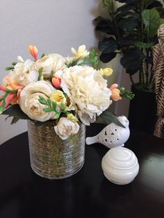 My newest arrangement...peonies, ranculus and freesia.
