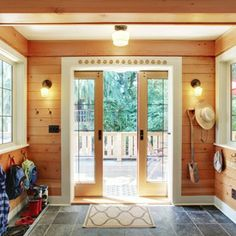 Exterior Pocket Doors Entry Mudrooms Satin Nikel Light Vanity Pendant Bright Wooden Wall And Ceiling Grey Ceramic Tile Floor Of Remarkable