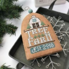 The first 3 ornaments in the White Christmas series have a theme: trees! Each one has a special memory from my family..❤️ #handsondesign #crossstitch #classiccolorworks #crossstitchersofinstagram #quietcolors #whitechristmas