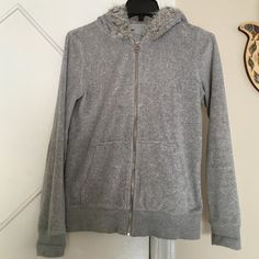 Michael Kors Hooded Sweater; 100% Authentic Beautiful, elegant, and chic, this sweater is perfect for any lady wanting to feel extra chic! Fully zippered, two side pockets; extremely warm; Pre-owned but in pretty good condition except the hood's fur is a little messed up by accidentally putting it in the dryer and the zipper label is a little discolored; price is negotiable and bundles are accepted! Michael Kors Sweaters