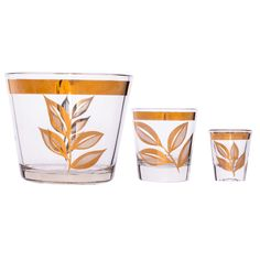 (VINTAGE) UTD GLASS - GOLD LEAF ROCKS GLASS (SET OF 5), SHOT GLASS (SET OF 6), & ICE BUCKET - $ 850.00 This mid century glassware set harkens back to a time when Chet Baker records crackled in the background of evening get togethers. The gold leaf overlay reminds us of a time when men wore suits and Hollywood was still a vision in black and white. Five rocks glasses, six shot glasses and an ice bucket make this set perfect for hosting in a most classic fashion.