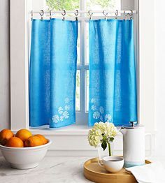 Turn a plain dish towel into delicate cafe curtains. Instructions: http://www.bhg.com/kitchen/remodeling/kitchen-projects/easy-diy-kitchen-decorating/?socsrc=bhgpin082715tailoredwindowtreatment&page=5