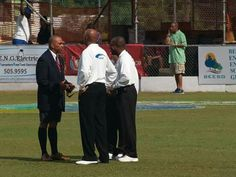 President Colin Smith speaks with umpires at Cup Match 2005.