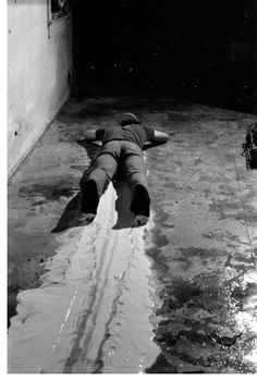 Paul McCarthy, Face Painting - Floor, White Line, film still of black and white videos (6:02 min), 1972. Contemporary art, film, film art, performance art, painting.