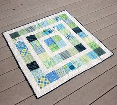 100 quilts in the bright sun by katie @ swim, bike, quilt!, via Flickr
