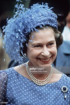 The Queen In The Solomon Isles During Her Official Tour Of The South Pacific Islands Wearing A Hat With Feathers (designed By Milliner Frederick Fox), Three-strand Pearl Necklace And The Empress Marie Feodorovna Of Russia's Sapphire, Diamond And Pearl Brooch.  (Photo by Tim Graham/Getty Images)