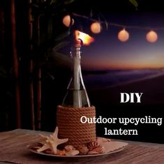 How to do upcycling and create an outdoor lantern with an old glass bottle upcycling diy doityourself tutorial candle lantern lanterne recyclage tutoriel Old Glass Bottles, Glass Bottle Crafts, Wine Bottle Art, Diy Bottle, Wine Bottle Lanterns, Diy Projects With Glass Bottles, Diy With Wine Bottles, Wine Bottle Decorations, Twine Wine Bottles
