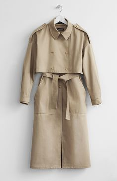 Two-piece long nude trench coat (44-45 inches (112-115cm long)) with belt and two front pockets. The length of jacket is 16 inches (40-42cm). Unlined. Made in Canada.