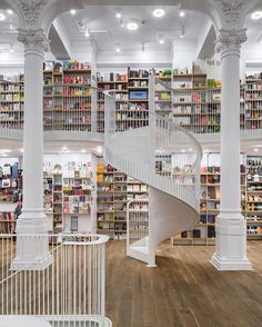 carturesti carusel bookstore in #bucharest by square one architecture. the restoration project adds two #spiralstaircases and mezzanines plus a skylit rooftop to a 19th-century building. @carturesti_carusel #carturesticarusel #spiralstairway photo by cosmin dragomir / arcaid #architecture on #designboom