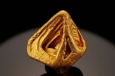 Native Gold crystal, Mina Zapata, Santa Elena de Uairen, Bolivar, Venezuela. Gold is exceptionally found in crystals. This specimen has a complex combination of forms, with an overall octahedral appearance and finely hoppered features. The crystal has a rich buttery golden hue and brilliant metallic luster
