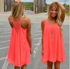Dress for vacay in a bright coral flowy dress! Crotchet detail on the back makes it extra sexy while staying comfy!