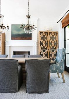 Blond Wood Dining Table with Charcoal Gray Slipcovered Dining Chairs different host chair dining room