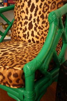 Re-painting wicker. Good, easy DIY design blog. RED CHAIR with Leopard cushion - LOVE - Livingroom