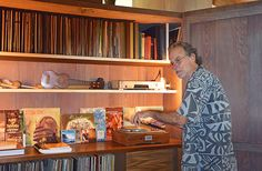 Bob Liljestrand reveals the hidden wall stereo at the Liljestrand house, complete with Hawaiian record collection.