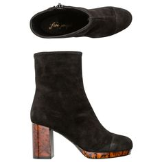 Free People Liquid Gold platform boot. Women's heeled boot. Retro styling. Leather suede uppers. Inside side zip. Tortoise heel and platform. Rounded toe. Imported. Vendor style #: OB547865.