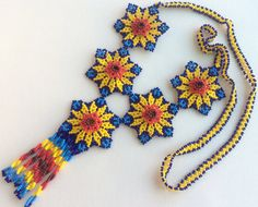 Mexican Huichol 5 Beaded Yellow and Blue Flowers por Aramara Beaded Flowers, Blue Flowers, Flower Necklace, Crochet Necklace, Mexican Jewelry, Mexican Designs, Peyote Patterns, Beaded Ornaments, Bead Art